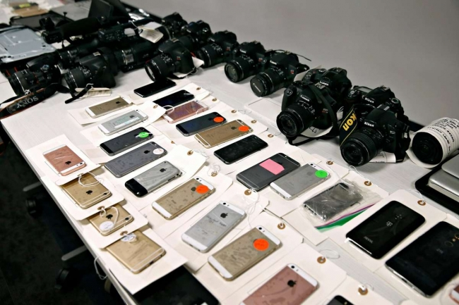Recovered electronics displayed at a news conference