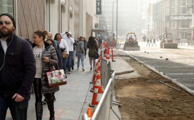 Workers put the finishing touches on the Winter Walk and the Central Subway construction project on Stockton Street in San Francisco, Calif. on Monday, November 19, 2018. Photo: Scott Strazzante / The Chronicle